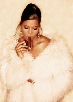 Queen Latifah smoking a cigarette (or weed)