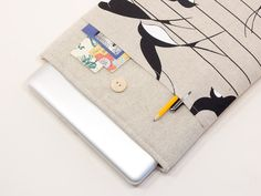 LINEN MACBOOK CASE WITH SWALLOWS POCKET AND WOODEN BUTTON CLOSURE $35.90