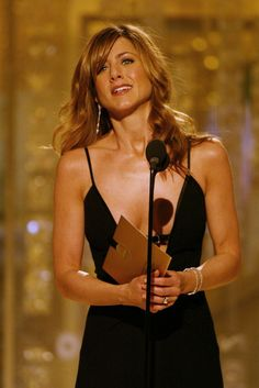 Jennifer Aniston Photos - (IMAGES NOT FOR SALE OR RESALE) Actress Jennifer Aniston presenting on stage at the 61st Annual Golden Globe Awards on January 25, 2004 at the Beverly Hilton Hotel, in Beverly Hills, California. - 61st Annual Golden Globes Awards - Show
