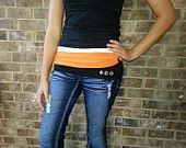 HALLOWEEN FANNY PACK! This design can be made for any holiday.  It's really cute on and it holds items like your phone, money, ID and lipstick. Just like a fanny pack, only it's cute.
