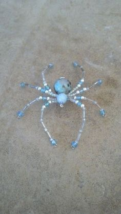medium beaded spider blue and silver by Natjerm on Etsy, $10.00
