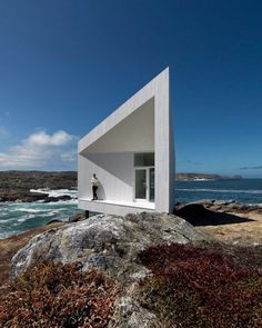 "The #SquishStudios located on #FogoIsland #Canada has a high back and low front #design making it look ""squished"" but intended to deflect the winds from the North Atlantic. Designed by @saundersarchitecture \\\ Photo by @notbent by designmilk"