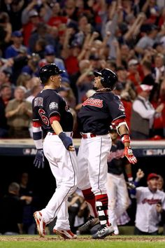 Rajai Davis #20 of the Cleveland Indians celebrates with Brandon Guyer #6 after hitting a two-run home run during the eighth inning to tie the game 6-6 against the Chicago Cubs in Game Seven of the 2016 World Series at Progressive Field on November 2, 2016 in Cleveland, Ohio. (Nov. 1, 2016 - Source: Ezra Shaw/Getty Images North America)