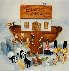 This carved Noah's Ark includes a detailed boat and ramp with a painted scripture verse on the roof. Description from noahs-ark.com. I searched for this on bing.com/images