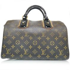 This is an authentic LOUIS VUITTON Monogram Mirage Speedy 30 Noir.   This is an unusual approach for Louis Vuittons Speedy bag with all of the features of the standard Speedy but here in the theme of noir or black.