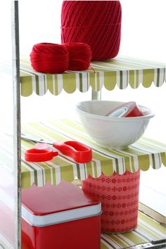 Use gift wrap to line a shelf, be sure to leave some for a decorative trim. HolidaywithMatthewMead.com