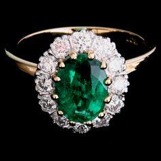 Oval emerald with brilliant cut diamonds