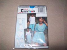 Burda Sewing Pattern 4296, top, blouse, skirt, shorts, Capri by vintagecitypast on Etsy