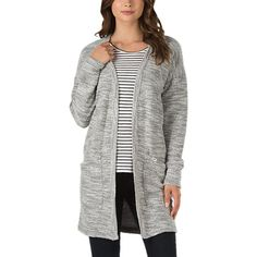 The Pinkys Cardigan is a 60% cotton, 40% acrylic loop knit open cardigan sweater with pockets. Model is 5 feet 9 inches tall and wearing a size Small.