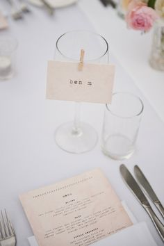Cards clipped to wine glasses with mini pegs