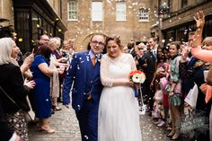Confetti in the Courtyard. Photography by Laura Ellen Photography http://www.lauraellenphotography.co.uk/