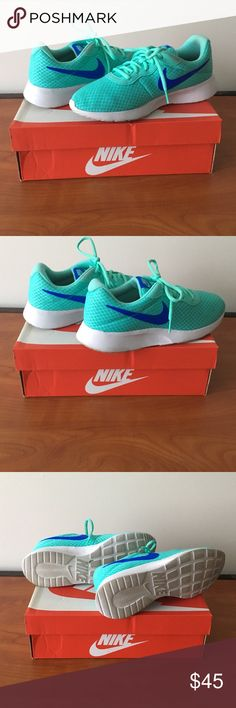 Size 9 Mint/White Women's Nike Tanjun Good condition. Gently worn on the soles. Some dirt on the side of the shoe (could be cleaned off). Original box and packaging! Nike Shoes Sneakers