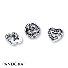Proudly share just how much your nearest and dearest mean to you with this delightful sterling silver trio. A sparkling heart, a family tree and two interlocked hearts form a perfect gift for any proud owner of a floating locket (sold separately). Note: These petite charms can only be worn inside the PANDORA Petite Memories Floating Locket designs. They cannot be worn on our classic bracelet or necklace designs or the PANDORA ESSENCE Collection. Style # 792022CZ.