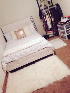 White tufted bed with rhinestones. White, gold decor. Faux fur pillows and rugs.  I did the whole room by myself.