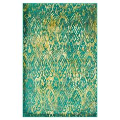Showcasing an ikat-inspired motif, this striking rug is equally at home anchoring your breakfast table or placed in the living room.