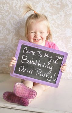 Great idea for a party invitation...child holding chalkboard with invite info.