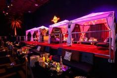 Several events brought decorative tents inside venues to house seating groups and bars. The Recording Academy's Grammy after-party had colorful, Indian-themed tents, and at Cash Money Records' Las Vegas-themed pre-Grammy party (pictured), Colin Cowie set up a section of black-and-white Hollywood Regency-style cabanas as lounge areas.