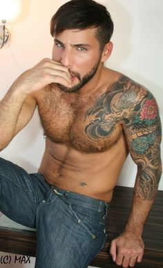 jonathan agassi  I don't care for tats but I really live a man with just the right amount of hair on his chest