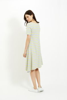 Grey flared dress with yellow stripe in 100% organic certified cotton. Knee length with short sleeves. Length 102cm.