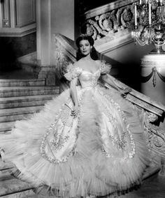 [The skirt's a bit much--okay, a whole lot much--but isn't the neckline pretty? Nice hairstyle too.]  Loretta Young