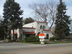 PT 84 NAMPA IDAHO MARCH 2014. AN ADOBE TYPE OF BUILDING SURROUNDED BY HUGE TREES.