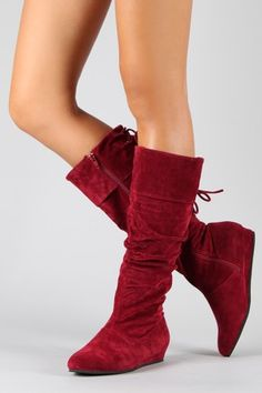 Knee high red boots.