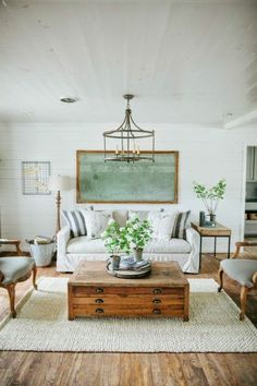 Living Room with Open Frame Chandelier - The Overgrown Ranch via Fixer Upper