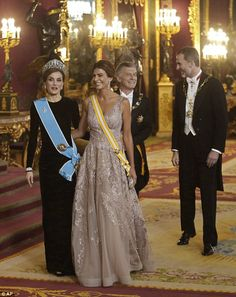 Spain's King Felipe, background right, his wife Queen Letizia, front left, Argentina's President Mauricio Macri, background left, and his wife Juliana Awada, front right, leave the throne room before a gala dinner at the Royal Palace, in Madrid