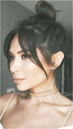 Marianna Hewitt bangs hair cut messy bun fringe Bardot modern #ShortBrunetteHairstyles Like what you see? click on the link to find out more.