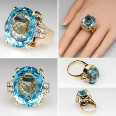 Giant Natural Aquamarine & Diamond Ring 14K Gold The natural aquamarine is a massive 27 carat eye clean stone with moderately strong saturation and medium light tone.