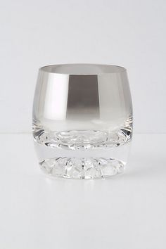 """The silver is a gradient going down to clear, and at the bottom the glass is pressed into a starburst pattern. """"Gin Rummy Glass"""" $18 from Anthropologie"""