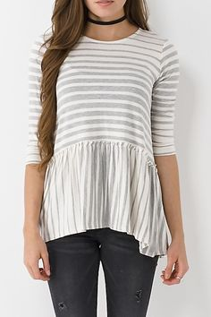 Features a striped grey and cream bodice, peplum hem and 3/4 sleeves. Pair this top with a scarf, cozy jacket and some super cute booties! 96% Rayon. 4% Spandex. Hand wash cold, hang or line dry.