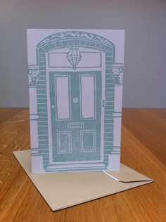 A lino print of our front door, which I added a wreath to to make our Christmas card for 2007