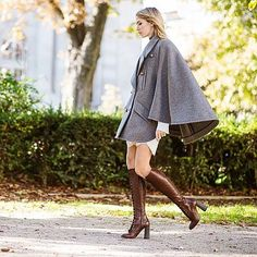 Stride through the changing seasons in a chic buttoned-up cape. Add a mini skirt and knee-high boots to make the most of the mild weather.