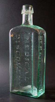 Kennedy's Medical Discovery - aqua green, applied lip, hinge mold, rectangular, 9 9/16in (218mm) tall. Embossing: MEDICAL DISCOVERY (back), DR KENNEDY'S (side), ROXBURY, MASS (other side). 1865 or so.