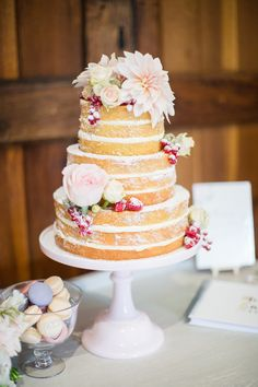 naked wedding cake with flowers - photo by Cecelina Photography http://ruffledblog.com/english-countryside-wedding-inspired-by-gardening