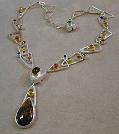 multi stone pendant and chain, hand forged. Sterling silver and 18kt gold. Pendant is detachable.
