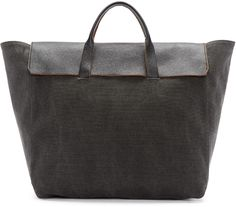 Unstructured canvas tote in 'dark ash' grey. Twin buffed leather carry handles in black at top. Grained leather foldover flap in black. Zip closure at throat. Tonal buffed leather pouch on integrated lanyard at interior. Tonal textile lining. Silver-tone hardware. Tonal stitching. Approx. 22