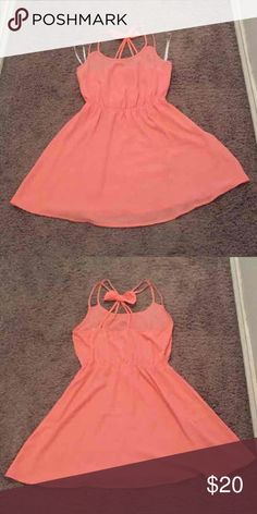 Coral Pink Dress with Back Bow Coral pink dress with cute straps and bow accent on back. Elastic waist. Fits size 4-6. Great condition. Mine Dresses Mini