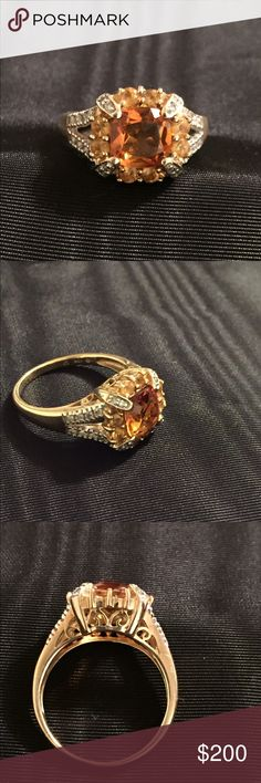 Cushion cut Citrine Ring 10K YG Beautiful 10K YG Citrine and Diamond ring.  This is a cushion cut citrine in the center with small diamonds on the corners and down sides.  I have the original tags but the ring is not new. I have worn it on occasions. Jewelry Rings