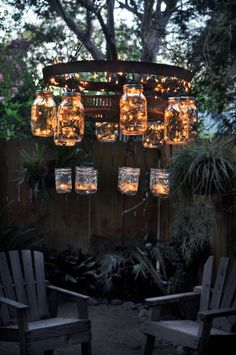 A cool recycled mason jar chandelier, outdoor room, garden chandelier.  This is made with mason jars, a wine barrel strap and some christmas lights.