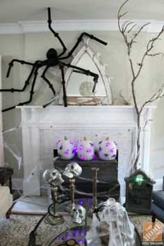 Kelly of Eclectically Vintage has a knack for taking mundane items and turning them into decorating statements. Look at her cute Halloween mantel! We love the carvable foam pumpkins with the flashing spider lights she added. Click through for the how-to.