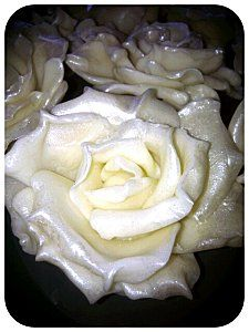 Wedding winter roses, made from cold porcelain. Waiting to be attached to a centerpiece.