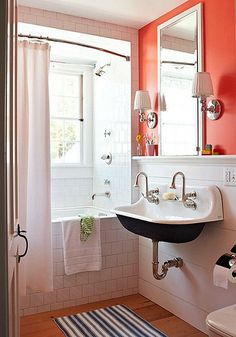 coral and navy - what a great idea!  I was searching for a color scheme for the new bathroom...this would go perfectly with the slate/blue granite tile floor!