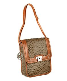 Practical and elegant, this handbag boasts peppered vegan leather for a signature look. With a slim, crossbody design, fashion and convenience are all in the bag.8'' W x 9.5'' H x 2.5'' DMan-madeImported