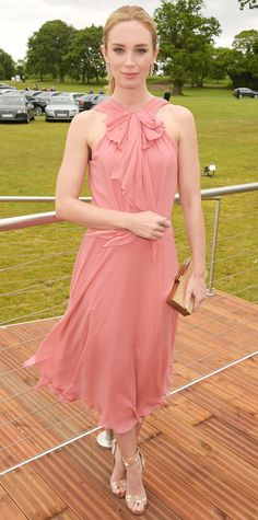 Look of the Day - June 01, 2015 - Emily Blunt in pink at the Audi Polo Challenge in a sweet blush neck-bow silk chiffon Jenny Packham dress, amping up the glam in gold drop earrings, a gilded clutch, and metallic laser-cut cork Nicholas Kirkwood sandals. #InStyle