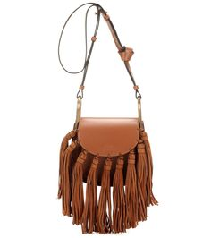 Chloé - Mini Hudson leather shoulder bag - Chloé's 'Mini Hudson' shoulder bag is a romantic, bohemian dream. In a conveniently compact design, it comes crafted in Italy from smooth calf leather in a sumptuous caramel hue. Oversized suede tassels provides retro character, while the knotted shoulder strap gives it a casual finish. seen @ www.mytheresa.com