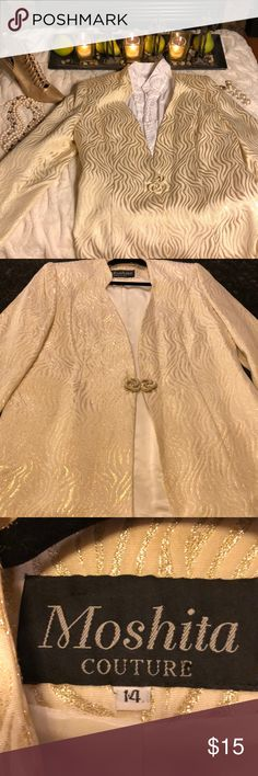 Moshita Couture Gold/Cream Jacket Beautiful Moshita Couture Jacket.  I bought this from someone and never wore it. This jacket is so beautiful but has been worn. The only problem I personally see with the Jacket is that the bottom of the coat in the very back - it looks to me like it needs to be ironed or professionally cleaned and then ironed to get the lining straight. It doesn't appear to have been ironed correctly. I have majorly adjusted the price for that. Please look closely at the…