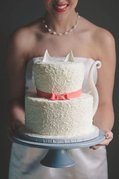 This cake gives a nod to the cats with its ear toppers and tail! | from Modern Cat Bridal Shower Inspiration by @Tidewater and Tulle