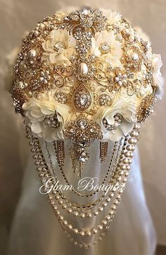 "Custom Gold and Ivory Cascading Bridal Brooch Bouquet - $599.00 9.5"" (27"" in circumference) Custom Gold and Ivory Cascading Brooch Bouquet - $599 - Deposit to Place your order - $399.00 - Balance due"